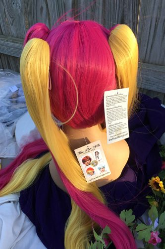 Plumeria wig back view with ponytails