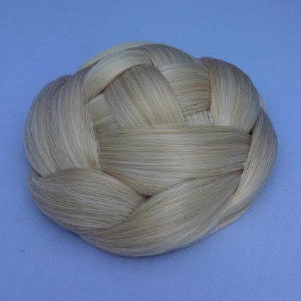 "braided bun in ""friendship blond"" color"